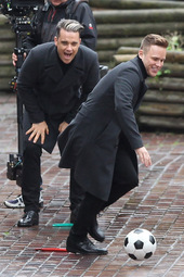 Robbie Williams and Olly Murs shooting a music video